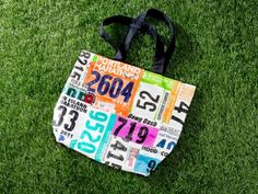 A bag made of race bibs. Perfect and stylish way to showcase your achievements. We have some other bib keepsake ideas on the Women's Running website! Will have to start saving my race bibs! I Love To Run, Run Like A Girl, Girls Be Like, Running Bibs, Running Medals, Disney Running, Running Gear, Columbus Marathon, Running Magazine