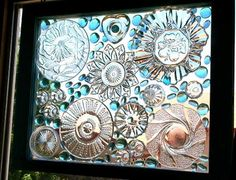 Just lots of glass bits glued to an old window - beautiful!!