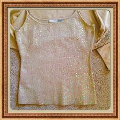 Sequined front tank top Sweater tank with sequined front. Adjustable straps. 66% silk 31% nylon 3% Spandex color is a champagne beige. Tops Tank Tops