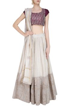 Off white zari embroidered lehenga and maroon blouse set available only at…