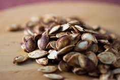"""What are pepitas? Pepitas (aka pumpkin seeds) are nutritional powerhouses, full of immune-boosting minerals like magnesium and zinc. Plus, unlike so many """"superfoods"""" they're super-affordable! Here's how and why to incorporate them into your diet often! Flavored Pumpkin Seeds, Roasted Pumpkin Seeds, Roast Pumpkin, Pumpkin Spice, Spiced Pumpkin, Protein Rich Snacks, Healthy Snacks, Healthy Eating, Collagen Rich Foods"""