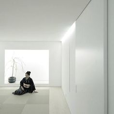 'House for Installation' renovation by Jun Murata in Japan. A carefully lit tranquil white space takes on two roles for its artist residence: home and exhibition space.