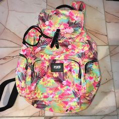 Pink back pack *NEW*  Never worn or used.  Super cute floral Hawaiian print backpack. Pink Victoria secret PINK Victoria's Secret Bags Backpacks