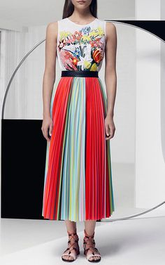 Spring florals and 1960s op art trickery play inspiration for the London-based queen of print's optical illusions this season. This high-waisted **Mary Katrantzou** skirt features multicolor accordion pleats and a vibrant digital print.