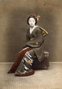 Image: Japanese School, (19th century) - Young Girl in a Kimono, c.1860-70 (hand coloured photo)