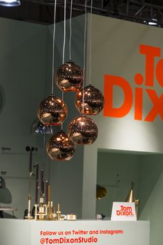 Clustered Copper Shades hang above our booth at ICFF #tomdixon