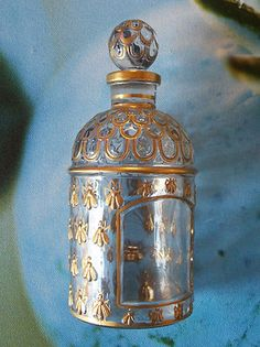 This is such a rare and beautiful  Vintage display Guerlain perfume bottle with hand painted gold bees.