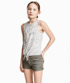Gray melange. Tank top in soft, cotton-blend jersey with a printed motif at front and ties at hem.