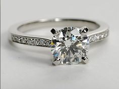 Milgrain style edges surround the elegant micropave diamonds on this elegant engagement ring.