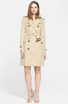 Women's Burberry Kensington Long Trench Coat. Classic trench styling-including storm flaps, epaulets and belted definition-elevate this long, double-breasted coat to urban-chic, weather-defying status. affiliate