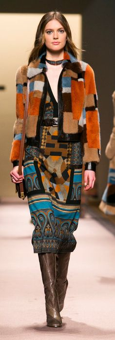 In the Etro Fall 2015 collection it is easy to see how contemporary fashion takes inspiration from the past. The design depicted here takes inspiration from the 1970's.The fur color blocking and boots were popular in the 1970's. 4/6/15