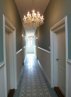 Modern Country Style: Ten Effective Decorating Ideas For Small, Narrow Hallways Click through for details. Modern Country Style: Ten Effective Decorating Ideas For Small, Narrow Hallways Click through for details. Hallway Chandelier, Hallway Lighting, Chandelier Ideas, Dark Hallway, Long Hallway, Dado Rail Hallway, Duck Egg Blue Wall, Hallway Paint Colors, Stairs