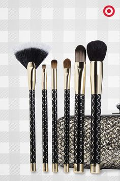 Six Sonia Kashuk makeup brushes and a statement-making gold-glitter clutch? Now that has 'gorgeous gift' written all over it—a beauty set, fit for holiday parties.