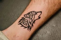 Small Outstanding Tribal Wolf Face Tattoo