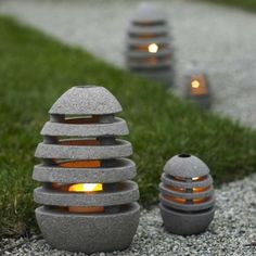 Stone Egg Candle Lanterns - VivaTerra. These lanterns have a natural yet very contemporary look to them. I love the idea of taking this medium and creating slats like a wooden piece where light can filter out for a great effect.