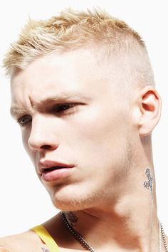 This high and tight haircut as an aggressively textured top. on Haircuts for Men | Pictures of Mens Haircuts and Mens Hair Care & Shaving http://haircutsformen.org/buzzblog/wp-content/gallery/pictures-of-mens-short-haircut/number-one-haircut-texture-top.jpg