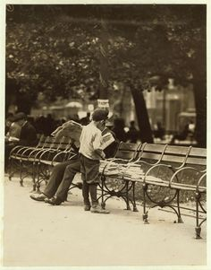Boy collecting discarded newspapers to sell to store-keepers, Union Square, New York City, July 1910