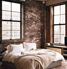 Exposed brick walls and big windows with black details. No curtains?                                                                                                                                                                                 More