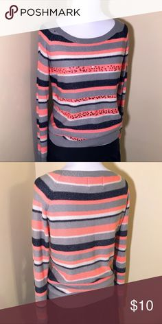 Decorative Striped Sweaterish-blouse Super cute with some subtle decorative sequin detail by Under Skies.  Long sleeves but it's very light with breathability.  Acrylic fabric is soft and shimmery.  Size Small.  Good used condition but there is a black mark on the tag (see pics).  Reasonable offers are always considered 😎🤝 under skies Sweaters