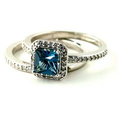 14K London Blue Topaz Engagement Ring & Matching Band Diamond Halo Wedding Set Custom Bridal Jewelry 18K White Yellow Rose Gold Platinum. $1,472.00, via Rare Earth on Etsy.