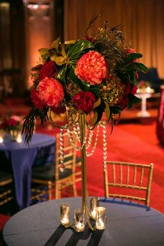 Masquerade Holiday Party in The Lodge at The Regency Center like no other...Aerialists, Opera singers, #feathers, #masks and #bejeweled florals abound!  #magnolia #peonies #mercury glass #hydrangea  Photographer: Gustavo Fernández Photographer  Florals: Soulflower Design Studio, come visit us at http://soulflowersf.com/