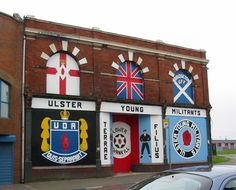 Loyalist murals on Shankill Road in Belfast. Surprisingly, this might be the scarriest place I've been. Northern Ireland Troubles, Belfast Northern Ireland, Belfast Murals, Man Of The House, Irish Blessing, Ireland Vacation, A Level Art, England And Scotland, Emerald Isle