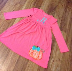 Dress your cutie in our cute Pumpkin dress. Made on a pink 100% cotton dress. Sizes 0-5T. Please provide name or initials for the embroidery