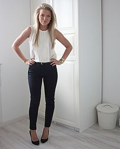 Black pants with simple white blouse. Add a cardigan for the classroom.