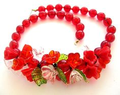 $98.00  Gorgeous glass flowers and beads on this very retro necklace..