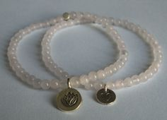 Rose Quartz Bracelet with Sterling Silver Lotus Charm. $25.00, via Etsy.