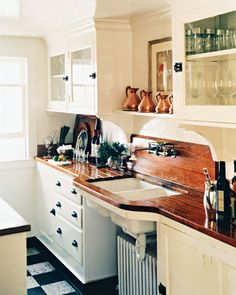 wood counters, white cabinets