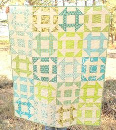 Modern version of a churn dash quilt