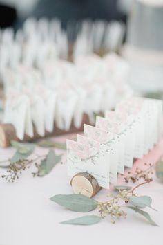 Escort Card Display Idea   See the wedding on SMP: http://www.StyleMePretty.com/new-york-weddings/new-york-city/brooklyn/2013/10/28/brooklyn-botanic-garden-wedding-from-dm-events-elisabeth-millay-photography/ Elisabeth Millay Photography