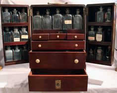 Antique apothecary or medicine chest, brass bound mahogany of George III or early English Regency. A fine chest such as would be found in good houses on campaign or at sea. The twin doors with lock open to reveal glass bottles and drawers with various items. The drawers with ivory handles. 18 inches high by 12 inches wide by 8 inches deep ( 45 cm by 30 cm by 20 cm) .- Gavin Douglas Antiques