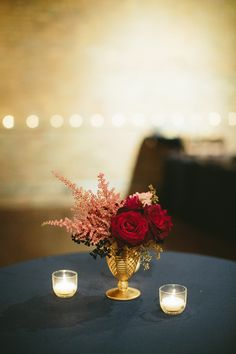 Simple astilbe and rose centerpiece.   Photography: Stoffer Photography  - stofferphotography.com  Read More: http://www.stylemepretty.com/2014/06/12/candlelit-indoor-chicago-wedding/