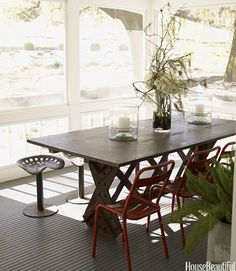 Dining chairs don't have to be part of a matching set. To accompany the table of this Napa Valley screened porch, designer Ken Fulk pulled up chairs salvaged from a French park and tractor-seat stools. Chairs through Chelsea Antiques.   - HouseBeautiful.com