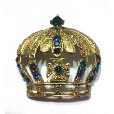 See this and similar brooches - This pretty crown brooch features sapphire,emerald,and ruby rhinestones. Hand set in shiny gold tone metal. The piece is unsigne...