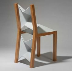 Crafty Wooden 'Flex Chair' uses clever Flat-folding Plastic - That's not a folding chair – this is a folding chair. It looks just like a regular wood-frame, white-backed chair you might find at a school desk or modest dining room table – but its deceptively simple surfaces have ultra-thin plastic joints that make it fold up like a piece of clever origami.