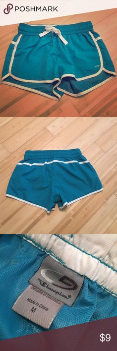 Champion women's athletic shorts These shorts have been worn a few times. No rips. Small stains: one on the back left buttock area and one on the front right bottom on the white. Overall comfortable and in good condition! Champion Shorts