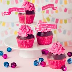 Pink, glittery, pink, festive, pink cupcakes in honor of the Cookbook Queen's birthday with free printable cupcake toppers from Bakingdom