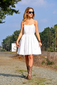 Loving how cowboy boots can dress down an outfit when paired with the right dress :).