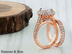 Cushion halo micro pave engagement ring and band with hand engraving.