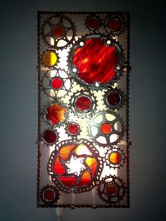 Recycled bicycle cog wall sconce with colored stained glass. $199.00, via Etsy.