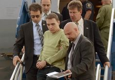 In this photo provided by Montreal Police, Luka Rocco Magnotta is taken by police from a Canadian military plane to a waiting van on Monday, June 18, 2012, in Mirabel, Quebec. Magnotta, the suspect in the killing and dismemberment and cannibalism of a Chinese student, returned to Canada via military transport from Germany, where he was arrested this month. (AP Photo/Montreal Police)