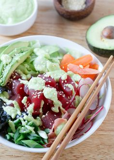Tuna Sushi Bowl with Avocado Wasabi Dressing. This quick and easy tuna sushi bowl is packed with radishes, carrots, cucumber, seaweed and avocado then drizzled in a spicy avocado wasabi dressing. Avocado Recipes, Fish Recipes, Lunch Recipes, Seafood Recipes, Asian Recipes, Cooking Recipes, Healthy Recipes, Dinner Recipes, Sashimi
