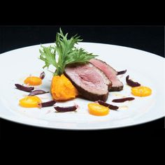 Moroccan | Spice-Crusted Duck Breast | Moroccan spice-crusted duck breast with roasted carrot-apricot puree, and a salad of black olives, kumquats, and baby arugula.
