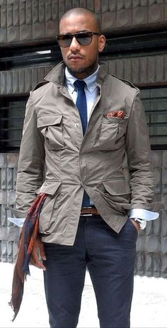 Taupe Safari Jacket, Navy Chinos, and Tie. Men's Spring Summer Street Style Fashion.