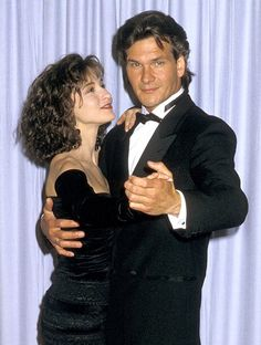 """Actors Patrick Swayze and Jennifer Grey attend the Annual Academy Awards at the Shrine Auditorium on April in Los Angeles. The pair starred in the 1987 film """"Dirty Dancing,"""" which won the Academy Award for Best Original Song. Jennifer Grey Patrick Swayze, Jennifer Grey Young, Dirty Dancing, Chevy Chase, Patrick Swazey, Patrick Wayne, Oscar Winners, Best Actor, 70s Fashion"""