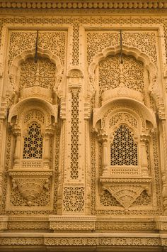 Very intricately carved and designed windows called jharokhas of a house made of. - Very intricately carved and designed windows called jharokhas of a house made of sandstone in the g - Indian Temple Architecture, India Architecture, Historical Architecture, Ancient Architecture, Beautiful Architecture, Architecture Details, Architecture Portfolio, Futuristic Architecture, Incredible India