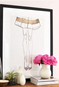 This fashion drawing makes an incredible backdrop to a simple but pretty nightstand.